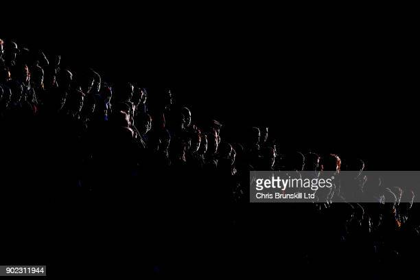 Shrewsbury Town fans look on during The Emirates FA Cup Third Round match between Shrewsbury Town and West Ham United at Montgomery Waters Meadow on...