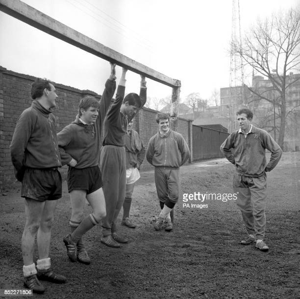 Shrewsbury Town FC captain Peter Broadbent discusses tactics with other members of the team as they prepare for the forthcoming FA Cup fifthround...