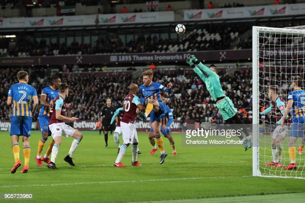 Shrewsbury Town goalkeeper Dean Henderson punches the ball clear during the Emirates FA Cup Third Round Replay match between West Ham United and...