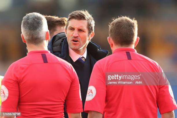 Shrewsbury Town manager / head coach Sam Ricketts has words with Match referee Sebastian Stockbridge during the Sky Bet League One match between...