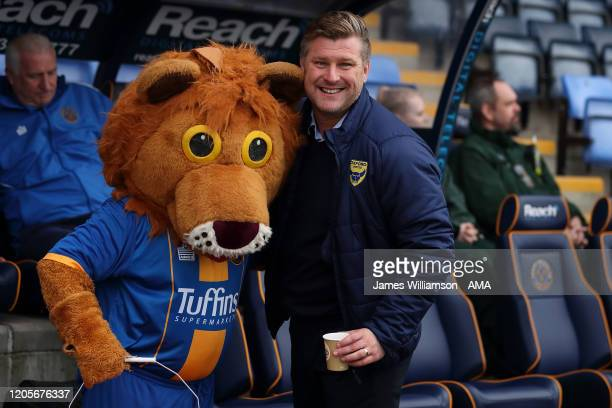 Shrewsbury Town mascot Lenny the Lion with Oxford United manager / head coach Karl Robinson during the Sky Bet League One match between Shrewsbury...