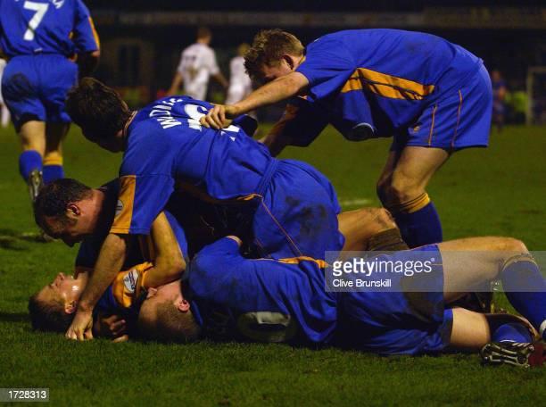 Shrewsbury Town players celebrate Nigel Jemson of Shrewsbury Town's winner during the FA Cup Third Round match between Shrewsbury Town and Everton...