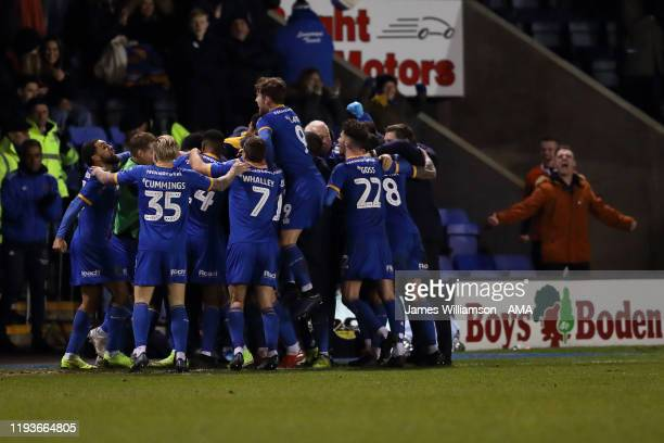 Shrewsbury Town squad celebrate after Aaron Pierre scored a goal to make it 10 during the FA Cup Third Round Replay match between Shrewsbury Town and...