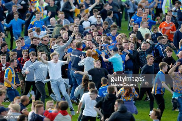 Shrewsbury Town supporters celebrate with goalkeeper Dean Henderson following the Sky Bet Division One playoff match between Shrewsbury Town and...