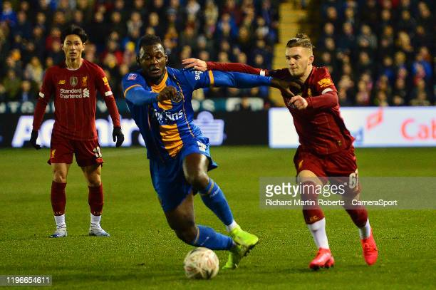 Shrewsbury Town's Aaron Pierre vies for possession with Harvey Elliott of Liverpool during the FA Cup Fourth Round match between Shrewsbury Town and...
