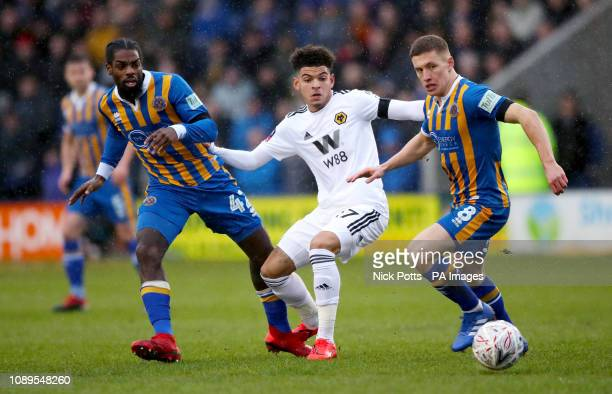 Shrewsbury Town's Anthony Grant and Greg Docherty battle for the ball with Morgan GibbsWhite during the FA Cup fourth round match at Montgomery...