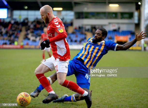 Shrewsbury Town's Anthony Grant tackles Charlton Athletic's Jonny Williams Shrewsbury Town v Charlton Athletic Sky Bet League One Montgomery Waters...