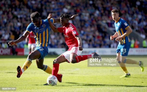 Shrewsbury Town's Aristote Nsiala and Charlton Athletic's Joe Aribo battle for the ball during the Sky Bet League One playoff second leg match at...