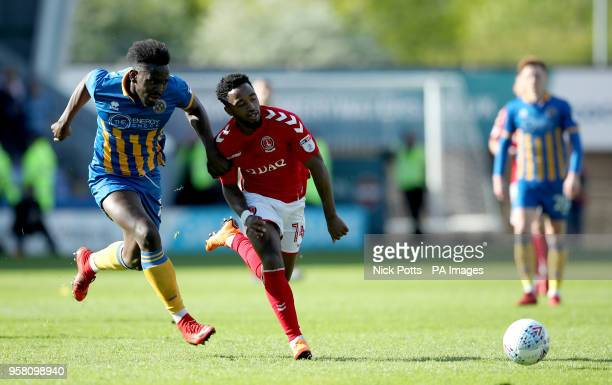 Shrewsbury Town's Aristote Nsiala and Charlton Athletic's Tarique Fosu battle for the ball during the Sky Bet League One playoff second leg match at...