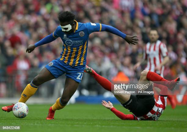 Shrewsbury Town's Aristote Nsiala and Lincoln City's Daniel M Rowe in action during the Checkatrade Trophy final at Wembley Stadium London