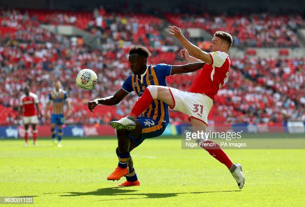 Shrewsbury Town's Aristote Nsiala and Rotherham United's Caolan Lavery battle for the ball during the Sky Bet League One Final at Wembley Stadium...