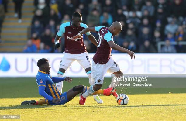 Shrewsbury Town's Aristote Nsiala challenges West Ham United's Andre Ayew and Cheikhou Kouyate during the Emirates FA Cup Third Round match between...