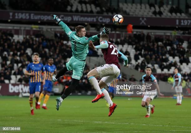 Shrewsbury Town's Dean Henderson denies West Ham United's Toni Martinez during The Emirates FA Cup Third Round Replay match between West Ham United...