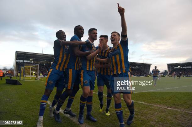 Shrewsbury Town's English defender Luke Waterfall celebrates scoring his team's second goal during the English FA Cup fourth round football match...