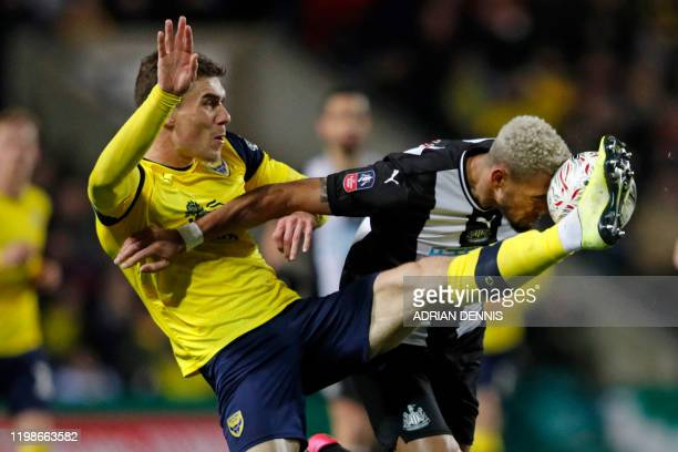TOPSHOT Shrewsbury Town's English defender Scott Golbourne vies with Newcastle United's Brazilian striker Joelinton during the FA Cup fourth round...