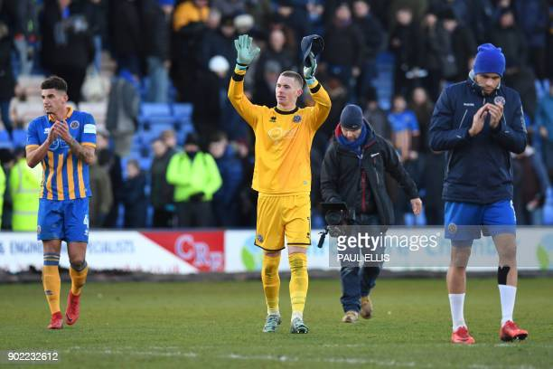 Shrewsbury Town's English goalkeeper Dean Henderson gestures after the English FA Cup third round football match between Shrewsbury Town and West Ham...