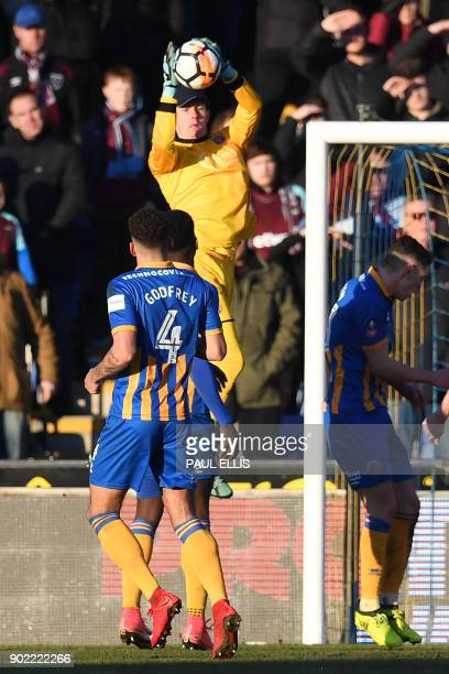 Shrewsbury Town's English goalkeeper Dean Henderson saves from a free kick during the English FA Cup third round football match between Shrewsbury...