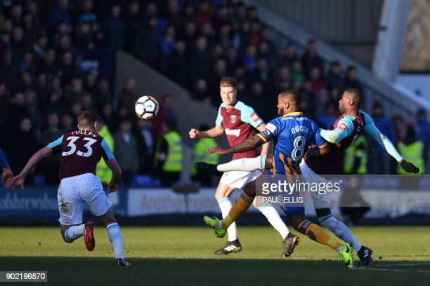 Shrewsbury Town's English midfielder Abumere Ogogo vies with West Ham United's Spanish midfielder Pedro Obiang as West Ham United's Englishborn Irish...
