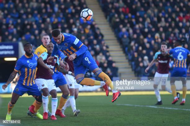 Shrewsbury Town's English striker Carlton Morris defends from a corner during the English FA Cup third round football match between Shrewsbury Town...
