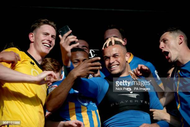 Shrewsbury Town's goalkeeper Dean Henderson Carlton Morris and James Bolton celebrate with a selfie at the end of the Sky Bet League One playoff...
