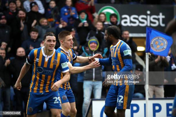 Shrewsbury Town's Greg Docherty celebrates scoring his side's first goal of the game with team mate Anthony Grant during the FA Cup fourth round...