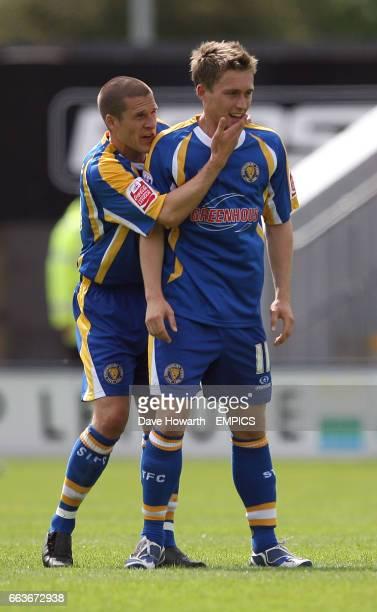 Shrewsbury Town's Jake Robinson is congratulated on scoring Shrewsbury's first goal