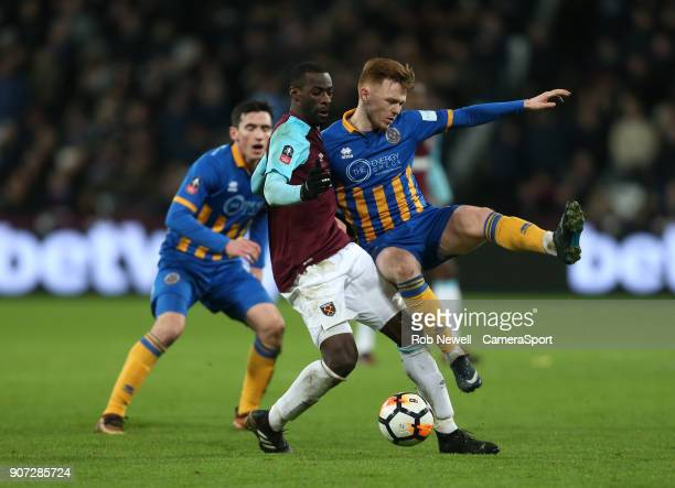 Shrewsbury Town's Jon Nolan and West Ham United's Pedro Obiang during The Emirates FA Cup Third Round Replay match between West Ham United and...