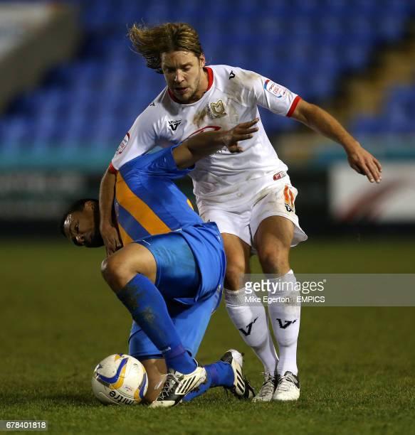 Shrewsbury Town's Julian Bennett and Milton Keynes Dons' Alan Smith