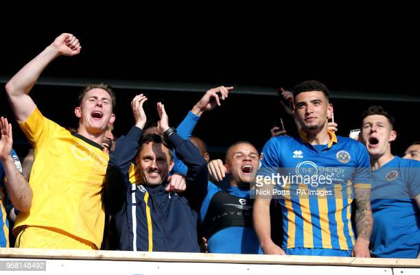Shrewsbury Town's manager Paul Hurst celebrates with goalkeeper Dean Henderson Carlton Morris Ben Godfrey and James Bolton at the end of the Sky Bet...