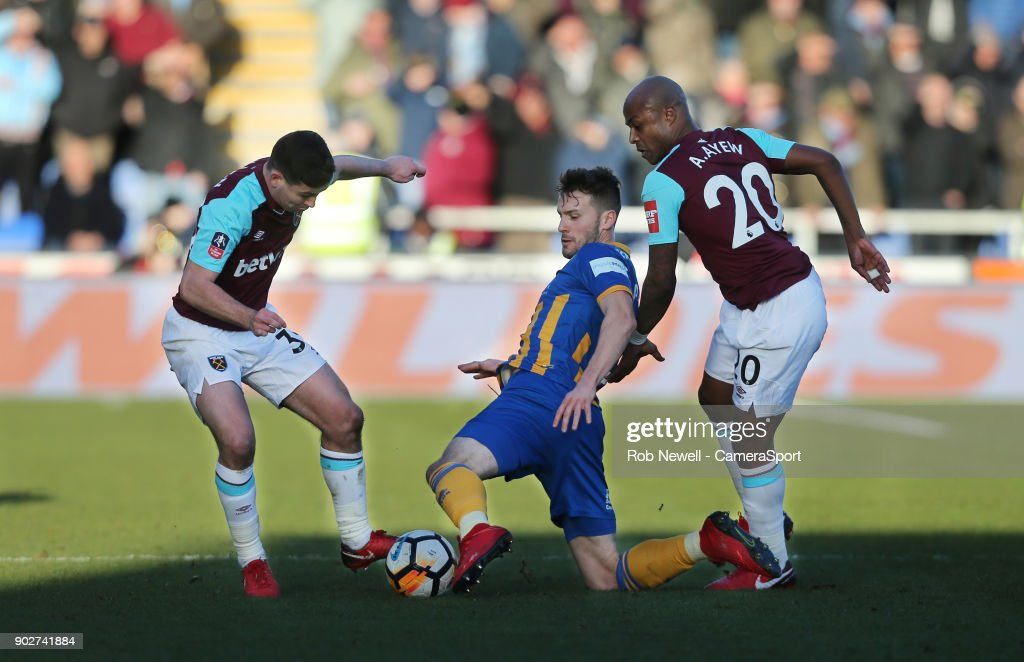 Shrewsbury Town's Mat Sadler gets in between West Ham United's Andre Ayew and Josh Cullen during the Emirates FA Cup Third Round match between Shrewsbury Town and West Ham United at New Meadow on January 7, 2018 in Shrewsbury, England.