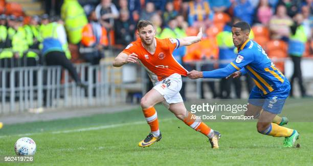 Shrewsbury Town's Max Lowe pulls the shirt of Blackpool's Jimmy Ryan during the Sky Bet League One match between Blackpool and Shrewsbury Town at...