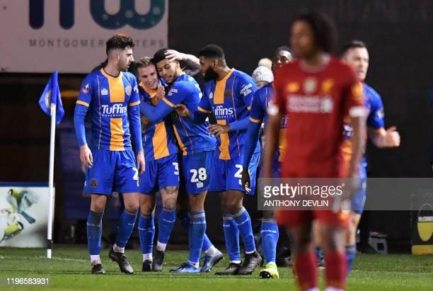 Shrewsbury Town's Scottish striker Jason Cummings celebrates scoring their second goal during the English FA Cup fourth round football match between...