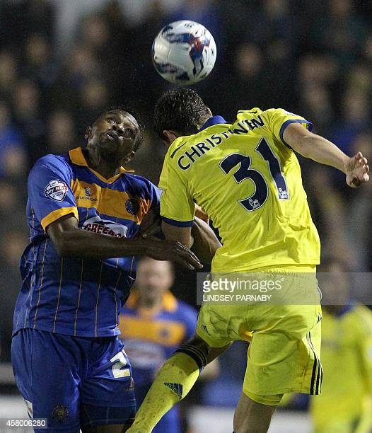 Shrewsbury's Frenchborn Ivorian forward JeanLouis Akpa Akpro vies for the ball with Chelsea's Danish defender Andreas Christensen during the English...