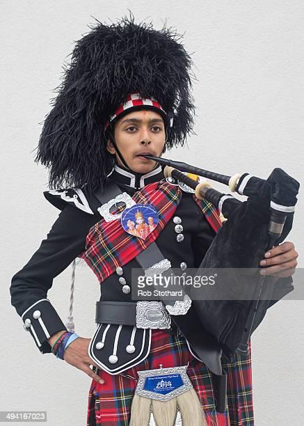 Shreyas Bhudia from the Shree Muktajeevan Pipe Band poses for a portrait before greeting Mayor of London Boris Johnson at the Shree Swaminarayan...