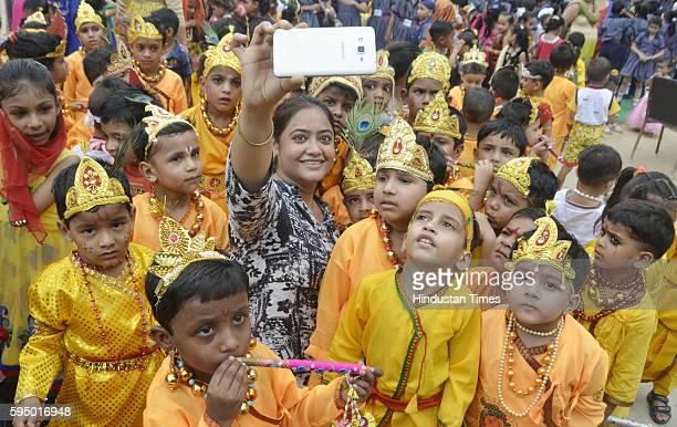 Shri Ram Ashram Public School children dressed up as Lord Krishna on the eve of Krishna Janmashtami celebration function held at school campus on...
