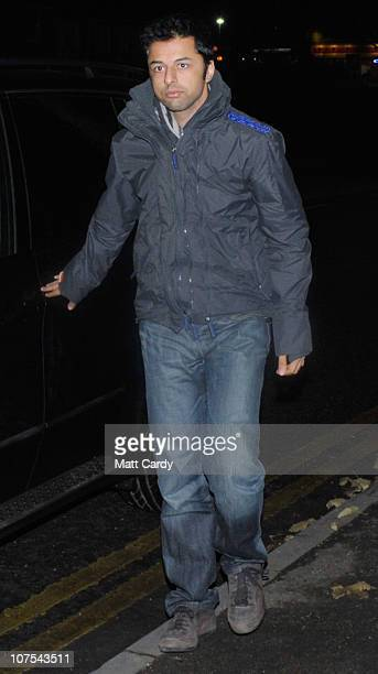 Shrien Dewani arrives at Southmead Police station escorted by police officers as he reports there as part of his bail conditions on December 12 2010...