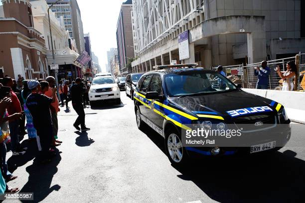 Shrien Dewani arrives at the Western Cape High Court in a South African Police cavalcade after having been succesfully exradited from the United...