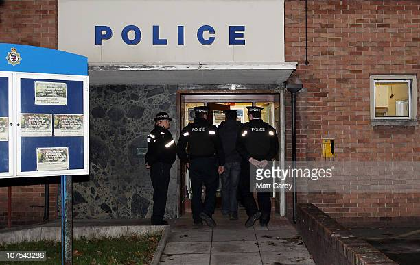 Shrien Dewani enters Southmead Police station escorted by police officers after he reported there as part of his bail conditions on December 12 2010...