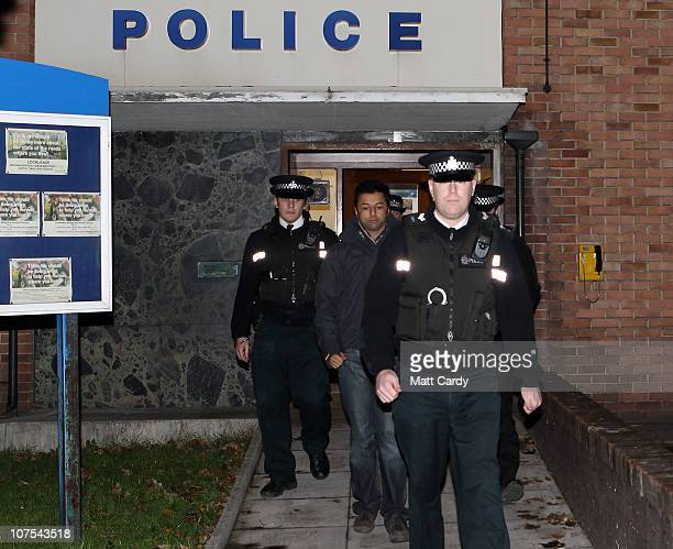 Shrien Dewani leaves Southmead Police station escorted by police officers after he reported there as part of his bail conditions on December 12 2010...