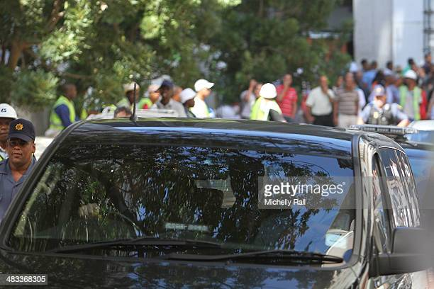 Shrien Dewani leaves the Western Cape High Court in a South African Police cavalcade for Valkenberg Psychiatric Hospital on April 8 2014 in Cape Town...