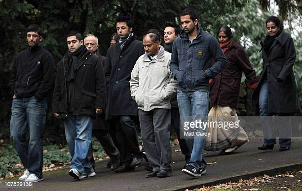 Shrien Dewani walks with his family on the way to pose for a photograph for waiting media at the family home on December 11 2010 in Bristol England...