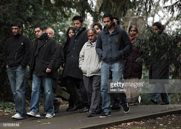 Shrien Dewani walks with his family on the way to pose for a photograph for waiting media at their family home on December 11 2010 in Bristol England...