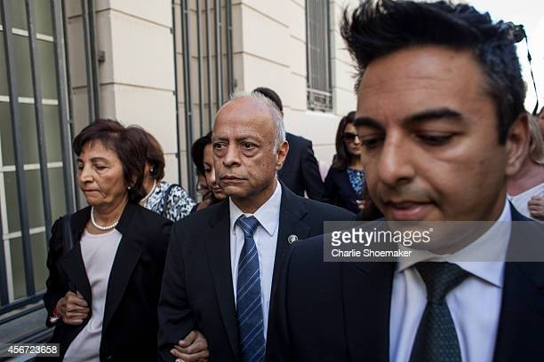 Shrien Dewani's mother Snila Dewani father Prakash Dewani and brother Preyen Dewani arrive at the Western Cape High Court for the start of their...