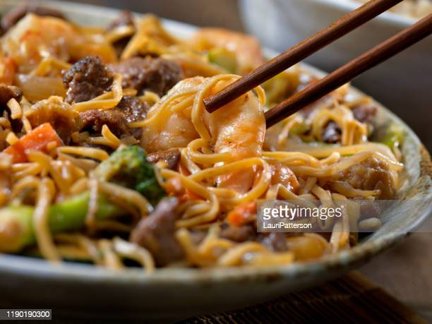 shrimp and beef chow mein - chinese food stock pictures, royalty-free photos & images