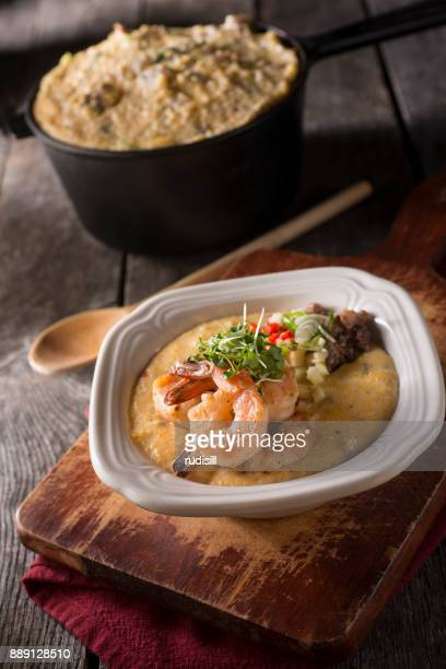 shrimp and grits - shrimp and grits stock photos and pictures