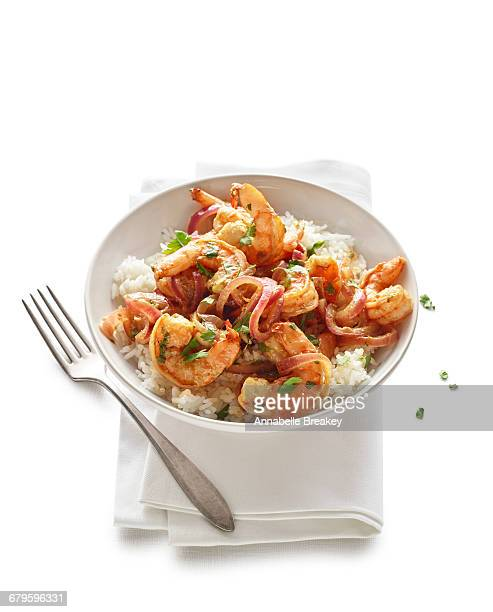 Shrimp and spicy mango sauté with fork and napkin