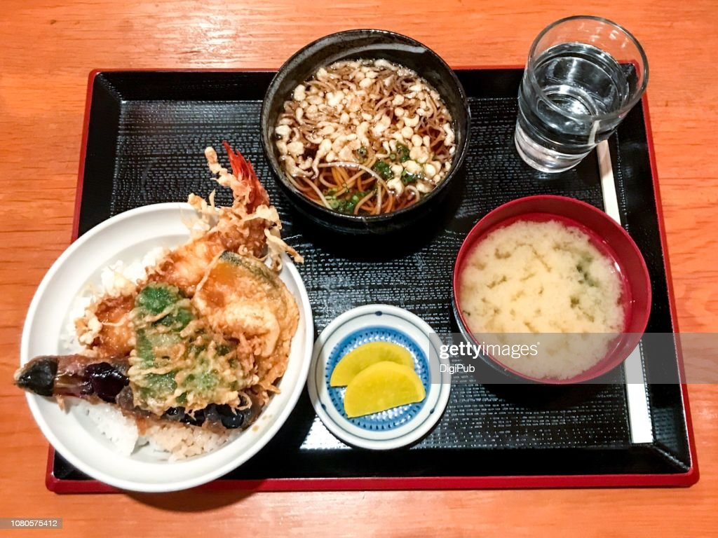 Shrimp and vegetable tempura donburi and warm buchwheat soba noodle lunch meal served in tray on table : Stock Photo
