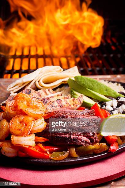 Shrimp, Beef and Chicken Fajitas with Flames