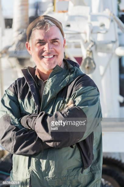 Shrimp boat captain on deck