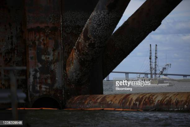 Shrimp boat moves past a decommissioned oil platform ahead of Hurricane Laura in Sabine Pass, Texas, U.S., on Tuesday, Aug. 25, 2020. Hurricane Laura...
